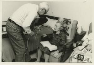 Primary view of object titled '[Photograph of Buelah Arvin with Lawrence Smith in Her Assisted Living Room]'.