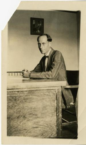 Primary view of object titled '[Photograph of H.E. Speck at Desk]'.