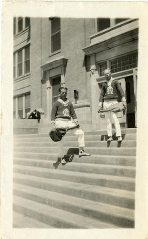 Primary view of object titled '[Photograph of Men on Steps with Tennis Rackets]'.