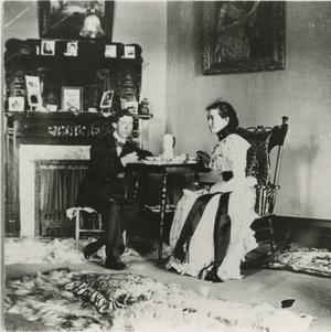 Primary view of object titled '[Photograph of Jesse and Daisy Sewell in Front of Fireplace]'.