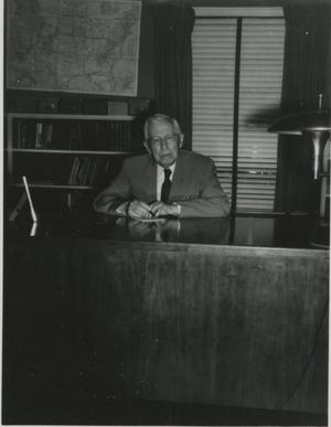 Primary view of object titled '[Photograph of Jesse P. Sewell at Desk]'.
