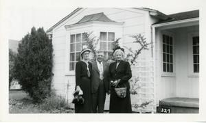 Primary view of object titled '[Photograph of Group in Front of House]'.