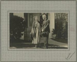 Primary view of object titled '[Photograph of Jesse and Daisy Sewell in Front of House]'.