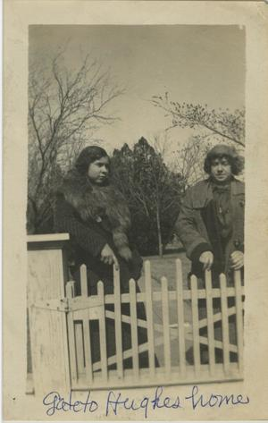 Primary view of object titled '[Photograph of Women Behind Fence]'.
