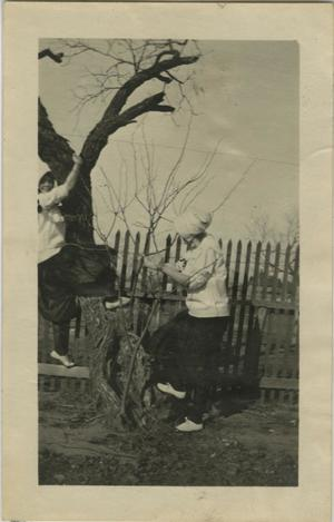 Primary view of object titled '[Photograph of Women Climbing Tree]'.
