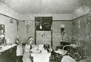 Primary view of object titled '[Photograph of Student Studying in Bedroom]'.