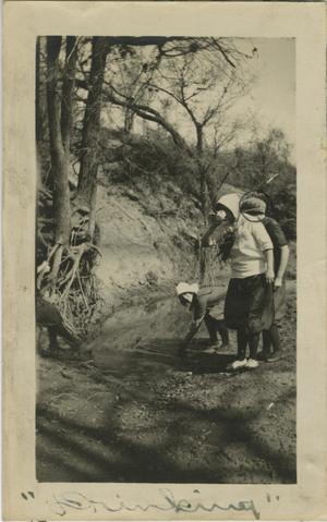 Primary view of object titled '[Photograph of Women Getting a Drink]'.