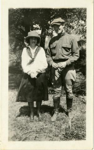 Primary view of object titled '[Photograph of Raymond Pitman and Woman in Field]'.