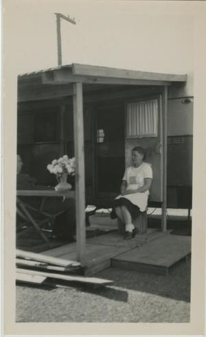 Primary view of object titled '[Photograph of Sauer under Motor Home Awning]'.