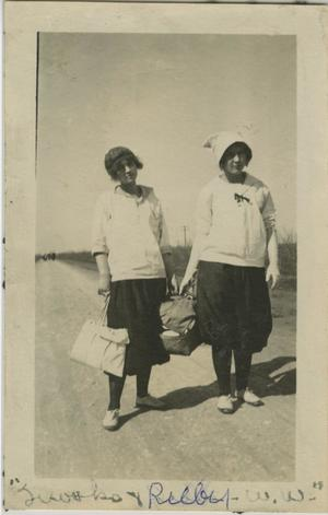 Primary view of object titled '[Photograph of Women Carrying Packages]'.