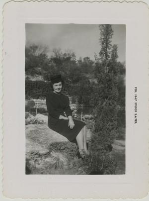 Primary view of object titled '[Photograph of Woman on Rock]'.