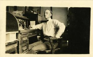Primary view of object titled '[Photograph of Hosea Lewis in His Office]'.