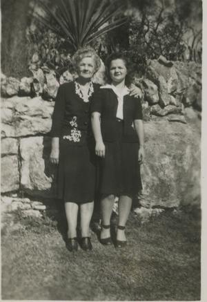 Primary view of object titled '[Photograph of Two Women in Front of Wall]'.