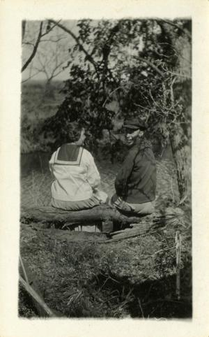 Primary view of object titled '[Photograph of Alta and Ivan on a Log]'.