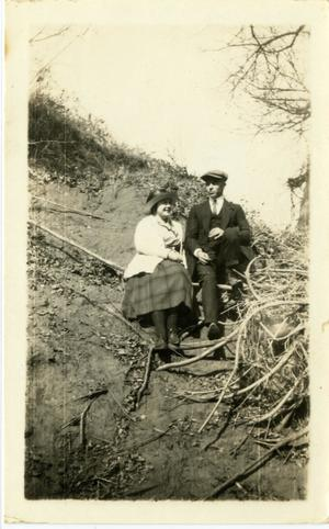Primary view of object titled '[Photograph of Ernest Witt and Alta Wood on Bank]'.