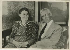Primary view of object titled '[Photograph of Jesse and Daisy Sewell on Front Porch]'.