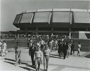 Primary view of object titled '[Photograph of Moody Coliseum with Students]'.