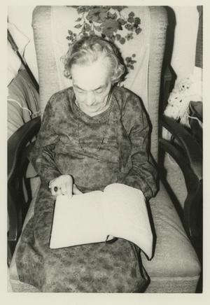 Primary view of object titled '[Photograph of Buelah Arvin Reading Bible]'.