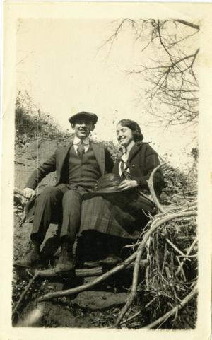 Primary view of object titled '[Photograph of Couple Sitting on the Ground]'.