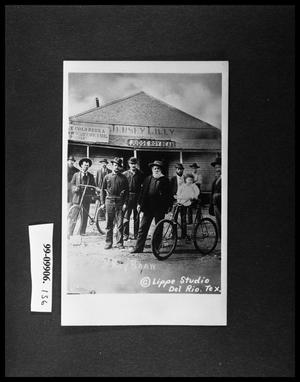 Primary view of object titled 'Men with Bicycles Outside Building'.