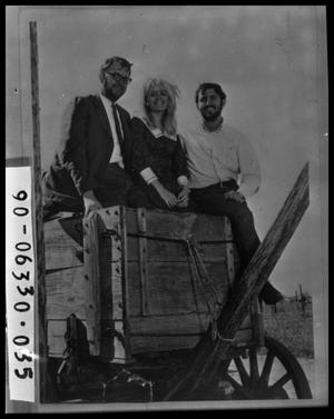 Three People on Wagon