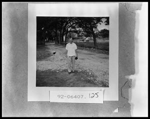 Primary view of object titled 'Man Standing on Road'.