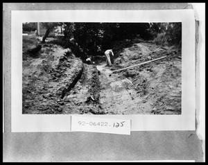 Primary view of object titled 'Man Working on Road'.