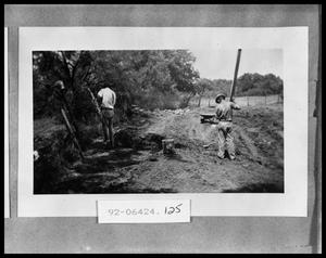 Primary view of object titled 'Men Working on Road'.
