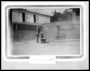 Primary view of object titled 'Man Working on Swimming Pool'.