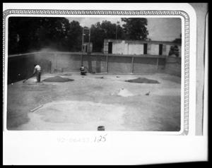 Primary view of object titled 'Men Working on Swimming Pool'.