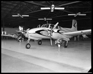 Primary view of object titled '[Airplanes on Display in Hanger]'.