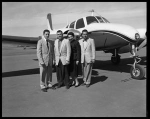 Primary view of object titled '[Group of People Posing with an Airplane]'.
