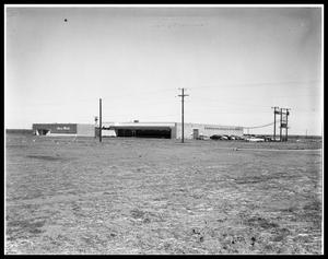 Primary view of object titled 'New Mayflower Moving Building on W. N. First'.