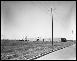 Primary view of object titled 'New Mayflower Moving Building on W. N. 1st'.
