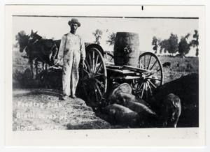 Primary view of object titled '[African American Man Feeding Pigs]'.