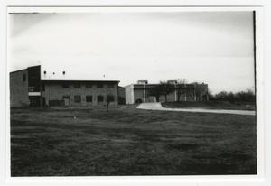 [View of Buildings Across Grassy Field]