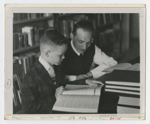 [Teacher and Student Study in a Library]