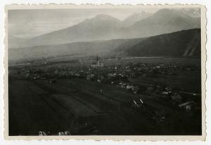 Primary view of object titled '[Photograph of Austrian Town and Mountains]'.