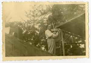 Primary view of object titled '[Photograph of Jack Benny Playing Violin]'.