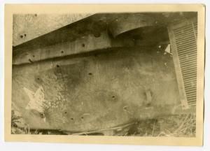 Primary view of object titled '[Photograph of Bullet Holes in Tank]'.