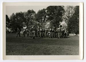 Primary view of object titled '[Photograph of 12th Armored Division Band Marching]'.