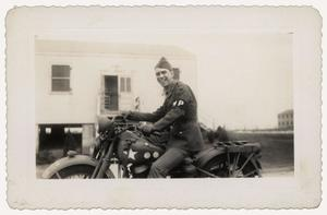 Primary view of object titled '[Photograph of Herman Kerngood on Motorcycle]'.