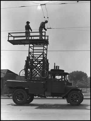 [Men Repairing Trolley Wire]