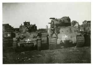 Primary view of object titled '[Photograph of Soldier and Tanks]'.