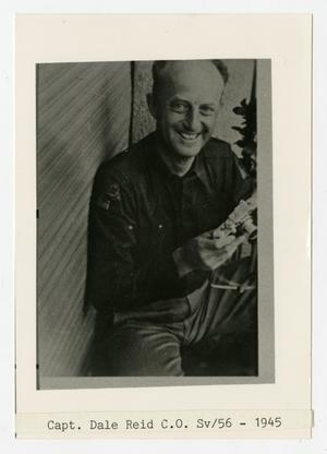 Primary view of object titled '[Photograph of Captain Dale Reid Holding Camera]'.