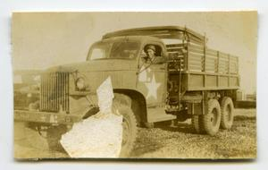 Primary view of object titled '[Photograph of Soldier in Truck]'.