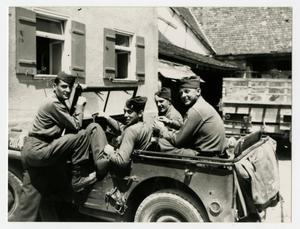 Primary view of object titled '[Photograph of Soldiers in Jeep]'.
