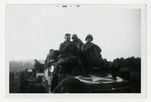 Primary view of object titled '[Photograph of Soldiers on Army Vehicle]'.