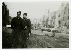 Primary view of object titled '[Photograph of Soldiers in Ruined Town]'.