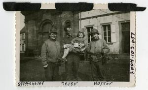 Primary view of object titled '[Photograph of Soldiers and Child in France]'.